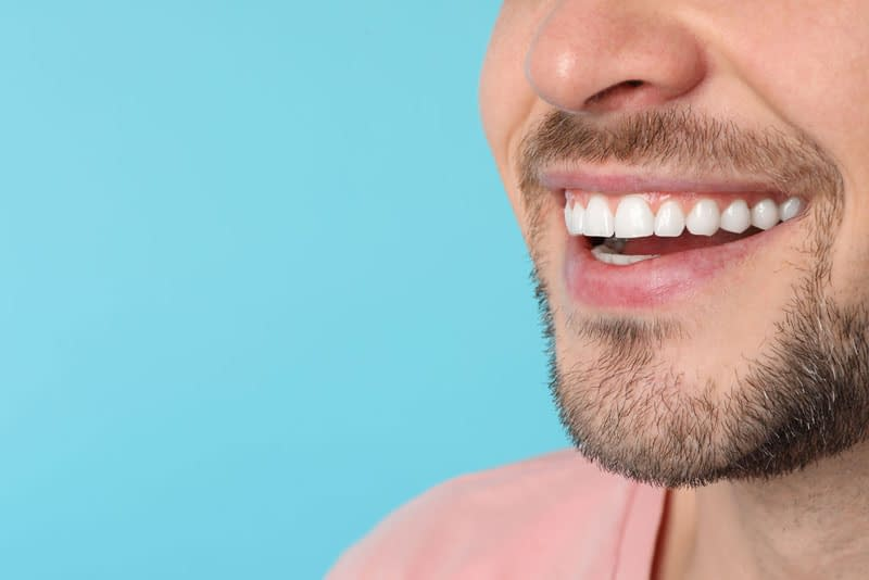 dental patient smiling after crown lengthening procedure