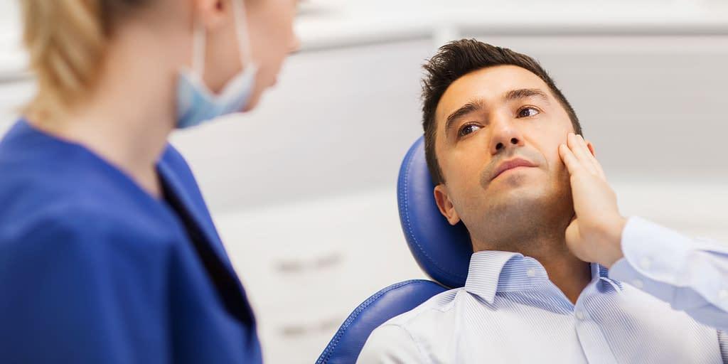 dental patient with teeth discomfort